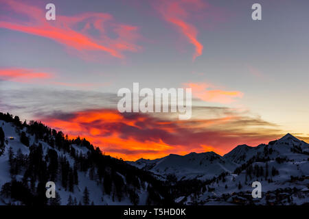 Fiery red skies at sunset over Obertauern, Austria - Stock Image