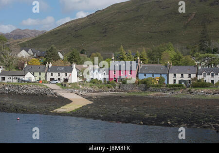 The Scottish north west coast sea front village of Dornie with colourful cottages. - Stock Image