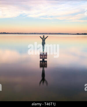 Eliza sculpture in the Swan River at dawn. The bronze sculpture depicts a woman diving off a platform & commemorates the location of Crawley Baths - Stock Image