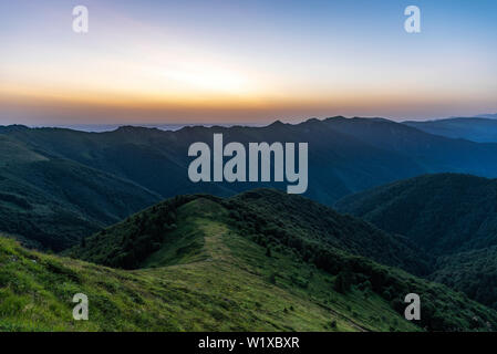 Scenic view of sunrise in the mountain. Landscape with copy space for text on sky. - Stock Image