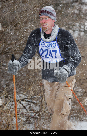 A competitor skis in the Mora Vasaloppet during a snowstorm on February 10, 2013 near Mora, Minnesota. - Stock Image