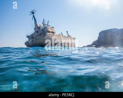 An abandoned shipwreck aground on rocks in Cyprus - Stock Image