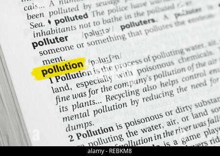 Highlighted English word 'pollution' and its definition at the dictionary. - Stock Image