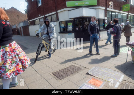 London, UK. 11th April 2019. Activists protested outside Tottenham Jobcentre Plus, speaking, handing out leaflets and talking with passers-by and calling for Universal Credit to be scrapped because of the great misery inflicted unnecessarily by the DWP on the working poor, single mothers and those with disabilities. From the start it has been marked by delays and inconsistencies by the DWP and a harsh benefits sanction regime that has unfairly penalised many, causing great suffering, huge rent arrears and making 1 in 38 new claimants last year homeless. Peter Marshall/Alamy Live News - Stock Image