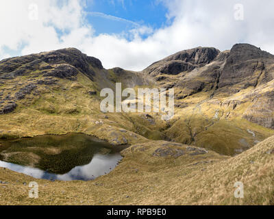 Bla Bheinn, Loch Fionna Coire and Coire na Uaigneich in the Black Cuillin Mountains on the Isle of Skye, Scotland, UK - Stock Image