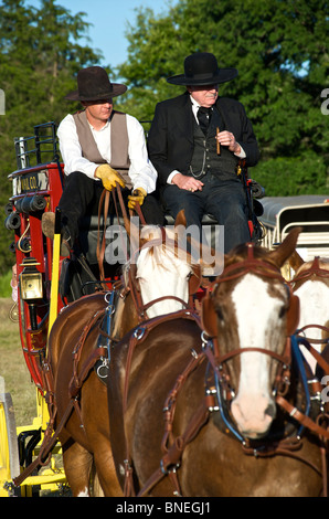 Historic Butterfield stage coach in small town PRCA rodeo Bridgeport, Texas, USA - Stock Image