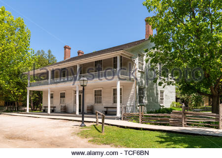 Halfway House Inn in the Black Creek Pioneer Village which is a famous place and tourist attraction. The landmark re-creates a country village of the  - Stock Image