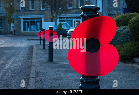 Large poppies decorate street furniture in memory of the centenary of  the end of World War 1. - Stock Image