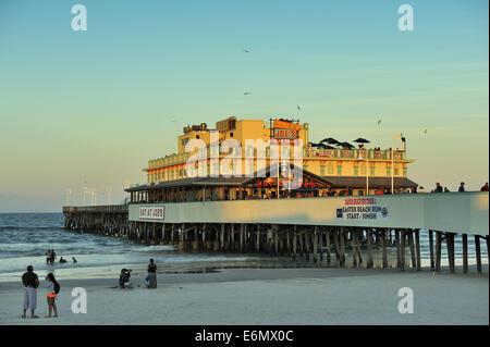 Daytona Beach Pier in the last light of the day. Daytona Beach, Florida, USA - Stock Image