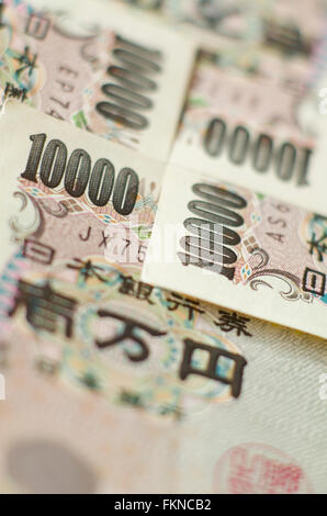 Close up of a pile of interlocked 10000 yen notes - Stock Image