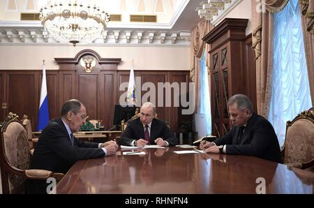 Moscow, Russia. 02nd Feb, 2019. Russian President Vladimir Putin, center, holds a meeting with Foreign Minister Sergey Lavrov, left, and Defense Minister Sergei Shoigu to discuss the Treaty on the Elimination of Intermediate-Range and Shorter-Range Missiles, after the United States announced their plan to withdraw from the disarmament agreement at the Kremlin February 2, 2019 in Moscow, Russia. Credit: Planetpix/Alamy Live News - Stock Image