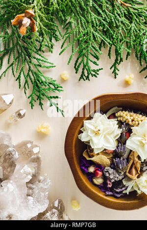 Dried Flowers and Herbs including Rose, Lavender, Sage and Paperwhites with Smoky Quartz and Incense Cedar - Stock Image