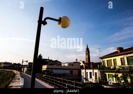 Lamp with view at the bell tower in sunset - Stock Image