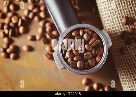 Espresso coffee machine handle with coffee beans - Stock Image