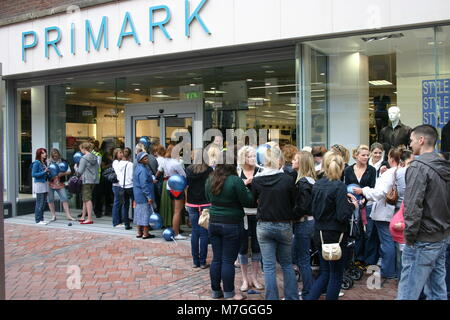 The sales and new store opening, with customers queuing outside Primark, Derby, UK - Stock Image