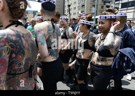 TOKYO, JAPAN - MAY 18: Heavily tattooed Japanese women chat in the street of Asakusa during 'Sanja Matsuri' on May 18, 2019 in Tokyo, Japan. A boisterous traditional mikoshi (portable shrine) is carried in the streets of Asakusa to bring goodluck, blessings and prosperity to the area and its inhabitants. (Photo: Richard Atrero de Guzman/ AFLO) - Stock Image