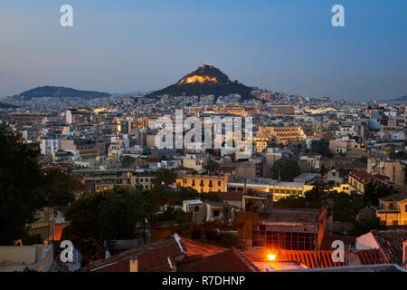 View of Athens dominated by Lycabettus hill. Image taken from Anafiotika in the old Town - Stock Image