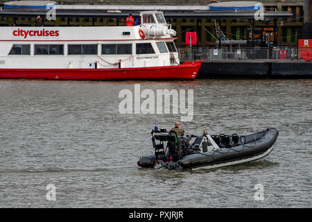 London, United Kingdom. 23 October 2018. Royal Marines conducting military exercises in the Upper Pool on the River Thames close to HMS Belfast. Credit: Peter Manning/Alamy Live News - Stock Image