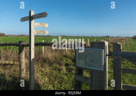 RSPB Medmerry Nature Reserve by the coast at Medmerry, West Sussex, UK. Map and sign posts or finger posts indicating footpaths from Earnley car park. - Stock Image