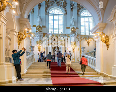 19 September 2018: St Petersburg, Russia - Tour parties on the main stairs of the Hermitage Museum. - Stock Image
