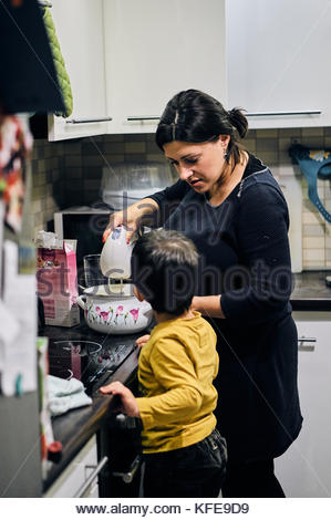 Woman and child baking together in a Polish household in Poznan, Poland - Stock Image