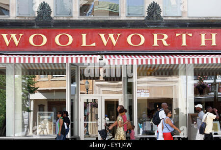 Woolworth store in Greensboro, North Carolina. People walking by the old Woolworth store. - Stock Image