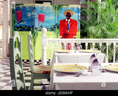 Tables are set for customers at Norma's on the Terrace. Kingston, Jamaica - Stock Image