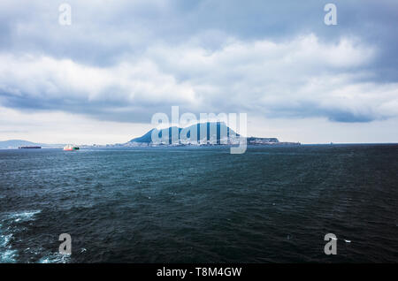 Gibraltar rock as seen from a ferry boat sailing across the Gibraltar strait. - Stock Image