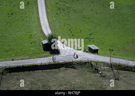 Walkers at a country cross-raods in Embrun, France - Stock Image