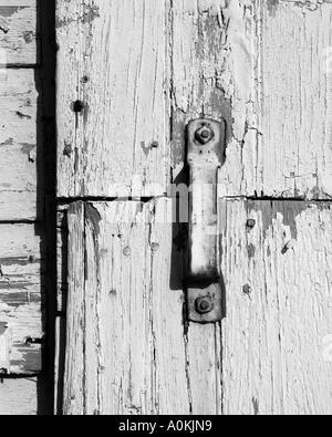 Detail in white. Door latch on New York garage, USA - Stock Image