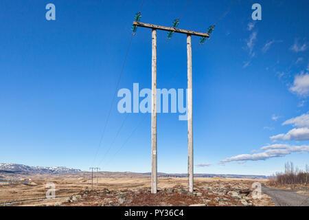 Pylons on the south coast of Iceland. - Stock Image