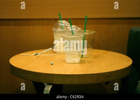 empty frapucchino cups at a coffee shop - Stock Image
