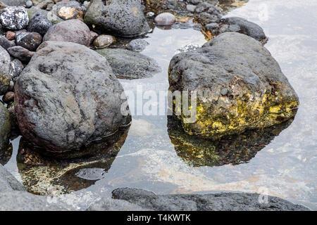 Small pools of seawater in rocks on the west coast, Playa San Juan, Tenerife, Canary Islands, Spain - Stock Image