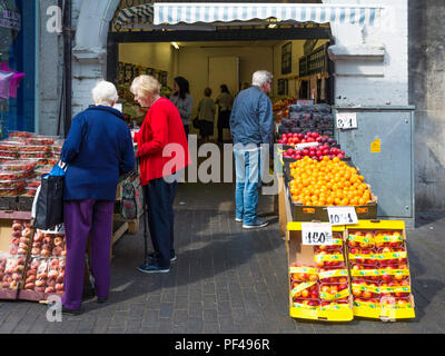 Customers at a greengrocer and fruiterers shop in an Archway in Middlesbrough Town Centre - Stock Image