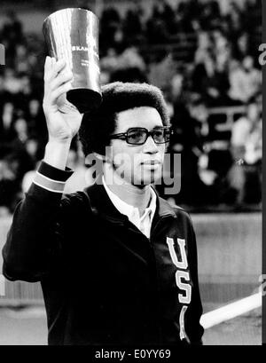 Nov 08, 1971; Stockholm, Sweden; In a hard fight between the American tennisplayer ARTHUR ASHE and the Czechish Jan Kodes in the Royal lawn tennis hall in Stockholm last sunday won Arthur Ashe with 6-1, 3-6, 6-2, 1-6 and 6-4. And Arthur Ashe who received about 50000 Swedish crowns for this victory also received the highest sum of money which ever had been up and down for Arthur Ashe. He has not succeed in playing as good as he would during his first year as professional player. The picture shows Arthur holding his trophy. - Stock Image