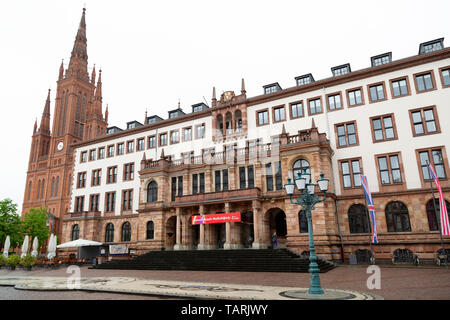 The City Hall (Rathaus) in Wiesbaden, the state capital of Hesse, Germany. The municipal building stands by the Market Church (Marktkirche). - Stock Image