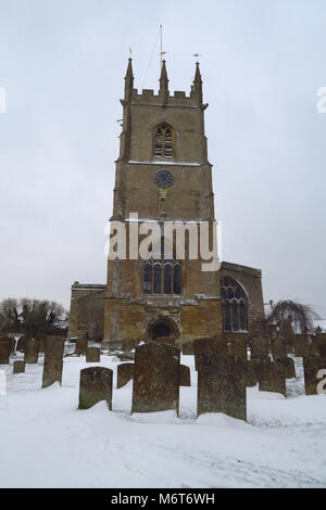 St Peter's Churchyard after a March snowfall, Hook Norton, Oxfordshire - Stock Image