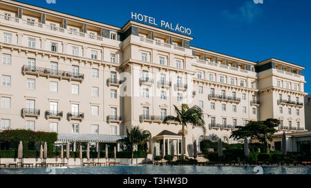 Estoril, Portugal - April 9th, 2019: Front facade of the famous Hotel Palacio which was frequented by both German and Allied spies during WWII - Stock Image