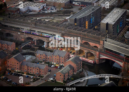 View from the South tower of Deansgate Square looking down at Manchester City Centres skyline around the Town Hall - Stock Image