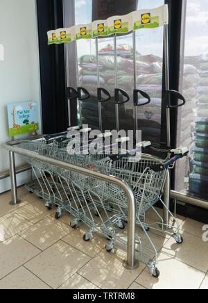 Fun size trolleys for children in Lidl supermarket. UK - Stock Image