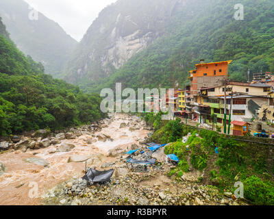Aguascalientes, Peru - January 5, 2017. View of the Urubamba river through the  Aguascalientes village in a rainy day - Stock Image