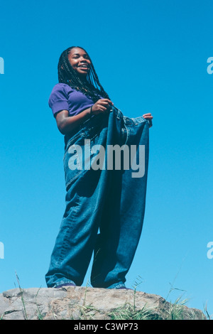 African American teenage girl wearing oversize pants - Stock Image