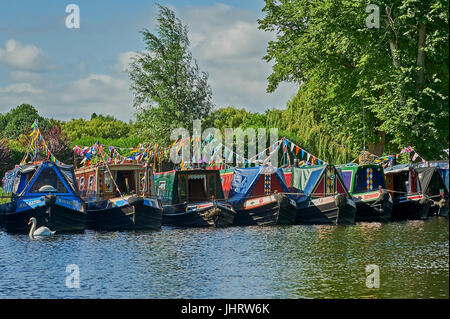 Narrow boats moored on the River Avon in Stratford upon Avon during the river festival. - Stock Image