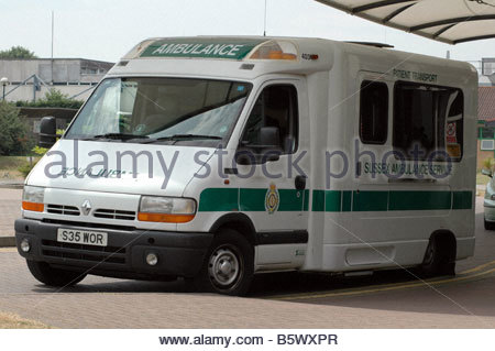 Ambulance outside St Richard's hospital Chichester West Sussex July - Stock Image