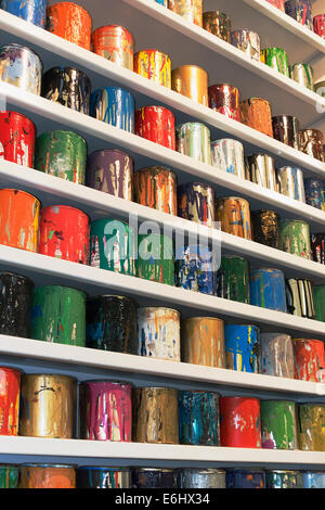 shelves with cans of silk screening paints - Stock Image