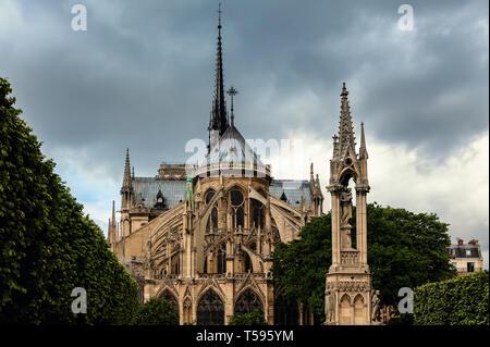 View of Notre-Dame de Paris Cathedral under cloudy sky. - Stock Image