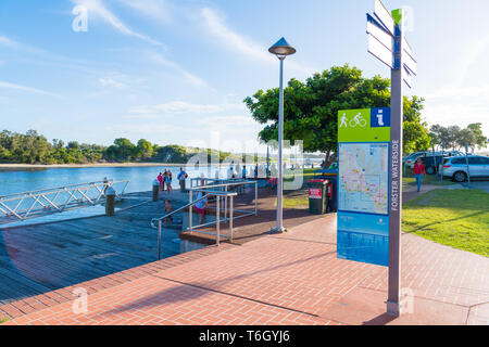 Forster, NSW, Australia-April 20, 2019: People enjoying the sunny weather on the waterside in the city of Forster, a coastal town in the Great Lakes r - Stock Image