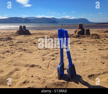 Sandcastles & Blue Spades - Stock Image