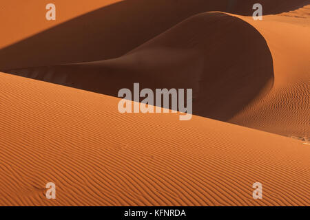 Close-up of lines, curves, shadows and textures of sand dune in Sossusvlei, Namib Desert, Namibia. - Stock Image