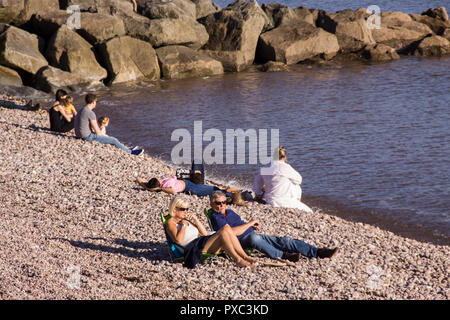 Sidmouth, UK. 21st Oct 2018. Unprecedented weather in Devon brought many flocking to Sidmouth beach,sunbathing in high temperatures. Photo Central/Alamy Live News - Stock Image